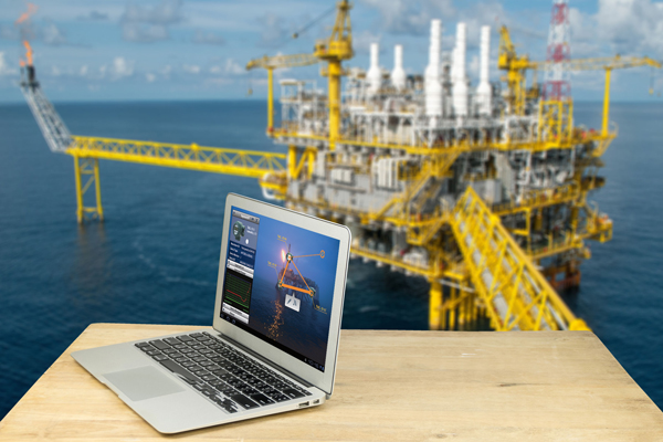 Image of PC and a plant in the oil and gas industry
