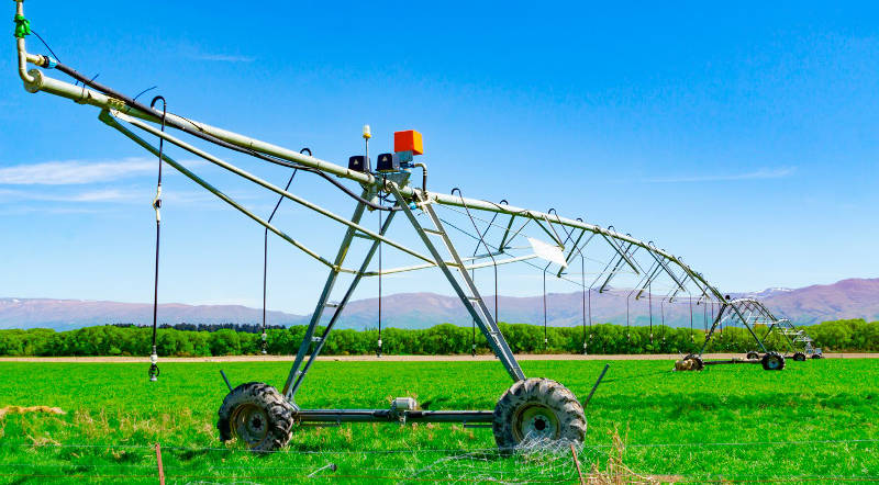 Large center pivot irrigation system running on a farm in Canterbury, New Zealand